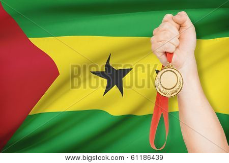 Medal In Hand With Flag On Background - Democratic Republic Of
