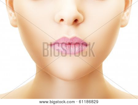 Part of face of young woman close up over white background.