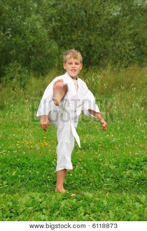 Karate Boy Kick A Leg Outdoor