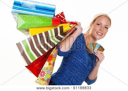 a young woman with colorful shopping bags while shopping. using credit cards for cashless payment