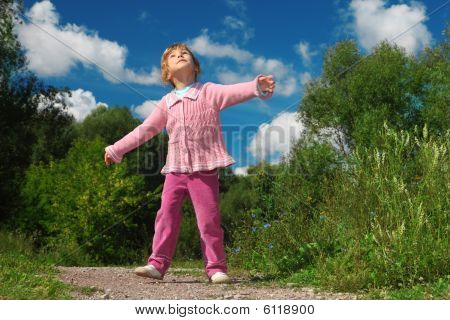 Little Girl Outdoor Looks Upward