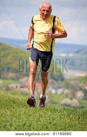 elderly joggers trained for his fitness by jogging