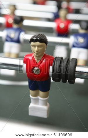 Closeup of Foosball character with red shirt
