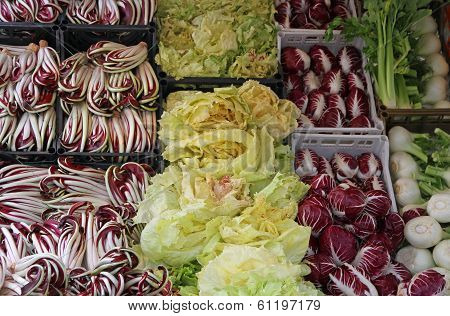 Red Radicchio And Chicory Salad And Other Fruits For Sale At The Market