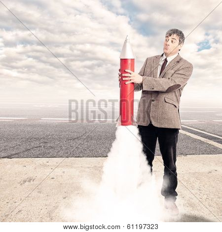 businessman holding a rocket at the airport