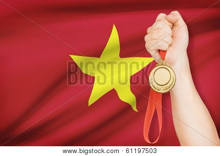 Medal In Hand With Flag On Background - Socialist Republic Of Vietnam