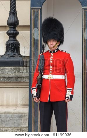LONDON, UK - CIRCA JUNE 2012: A royal guard is standing in front of  Buckingham Palace