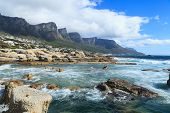 stock photo of mountain lion  - Beautiful Camps Bay Beach and Twelve Apostles Mountain Chain Cape Town South Africa - JPG