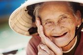 picture of toothless smile  - Close up face of beautiful smiling woman with wrinkles - JPG