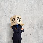 Man wearing carton box with target on head