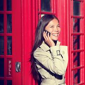 foto of phone-booth  - London woman on smart phone by red phone booth - JPG