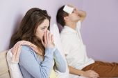 stock photo of high fever  - Sick woman and man have cold - JPG
