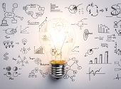 stock photo of lightbulb  - Light bulb with drawing graph - JPG