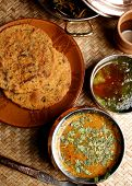 pic of rajasthani  - Gatte ki sabji is a traditional Rajasthani dish made with gram flour dumplings with dry spices steamed and then dunked into a yogurt based curry - JPG
