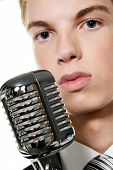 stock photo of singer  - a young singer with retro microphone singing karaoke - JPG