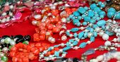 pic of flea  - vintage style jewelry and trinkets for sale at a flea market in Rome in Italy - JPG