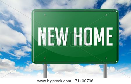 New Home on Green Highway Signpost.