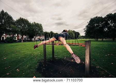 Woman Doing A Planche In The Park
