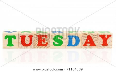 Word tuesday formed by wood alphabet blocks, isolated on white background
