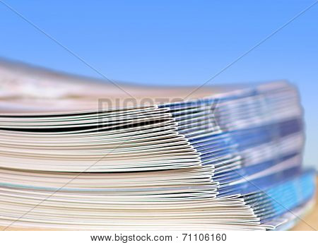Pile of magazines on a table