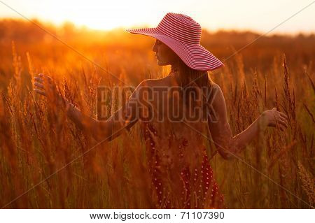 Happy Woman In A Hat Of The Meadow Grass
