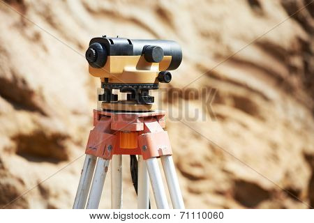 Surveyor equipment optical level or theodolite outdoors at construction site
