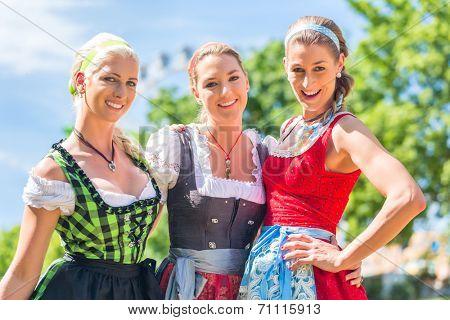 Women friends visiting Bavarian fair in national costume or Dirndl