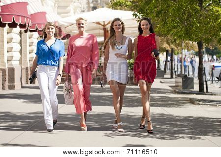 Portrait of a beautiful young four women walk on Red Square in Moscow