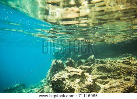 underwater world on wave background