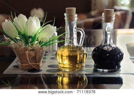 Oil And Vinegar On A Table In A C