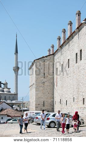 SAFRANBOLU, TURKEY - JUNE 24, 2012: Tourists under the wall of Cinci Han. This old caravanserai is operable today
