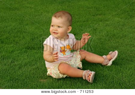 1 year old baby on grass
