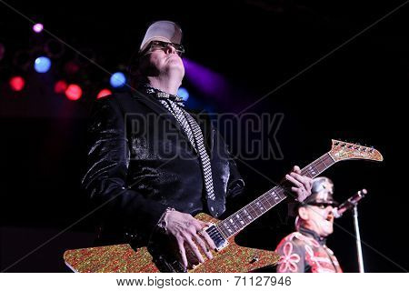 HUNTINGTON, NY-AUG 26: Lead guitarist Rick Nielsen of Cheap Trick performs in concert at the Paramount on August 26, 2014 in Huntington, New York.