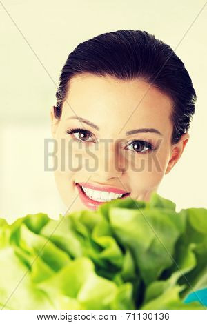 Portrait of attractive caucasian smiling woman with salat,  isolated on white