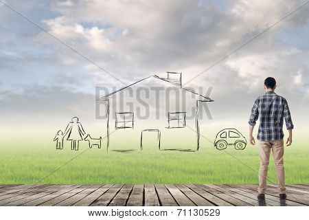 Asian man against the drawing house and family over grassland.