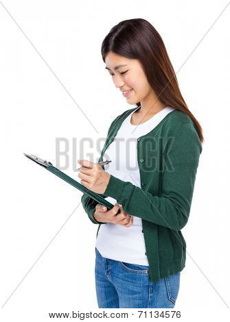 Girl write on clipboard