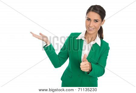 Presenting Isolated Businesswoman In Green Dress With Thumb Up.