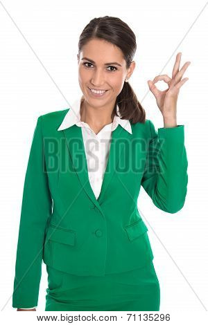 Isolated Businesswoman In Green Making Excellent Gesture With Fingers.