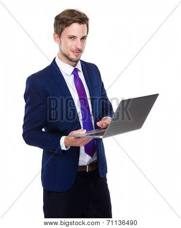 Caucasian man hold laptop