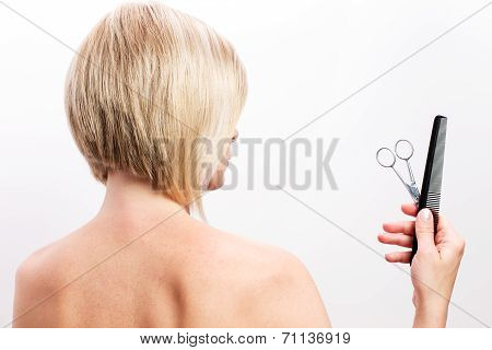 Short-haired Woman With Scissors And Comb In His Hand.