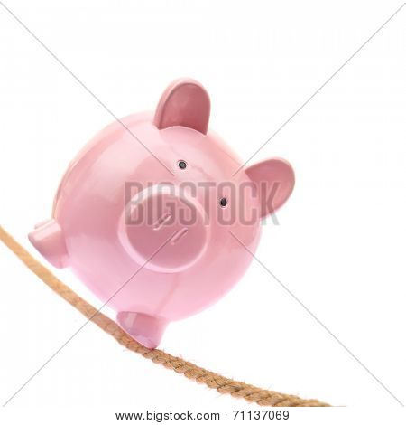 Piggy bank balancing on a rope