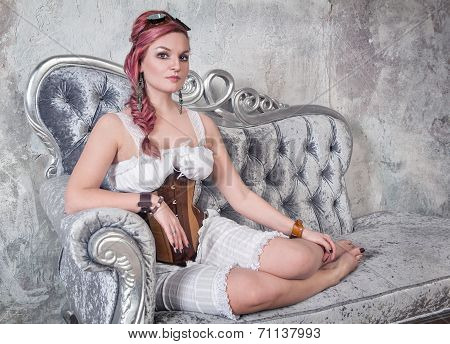 Beautiful Steampunk Woman On The Sofa