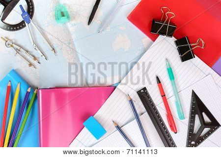 Background Of Notebooks, A Contour Map Of The World And Office Supplies