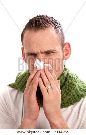 A Sick Man Blows His Nose.