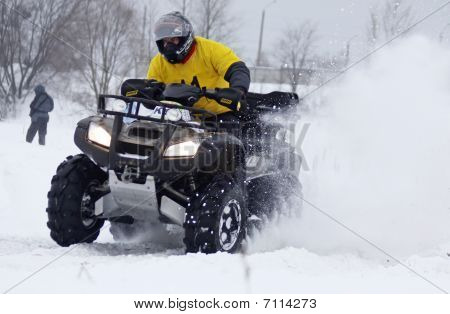 The Quad Bike Driver Rides Over Snow Track