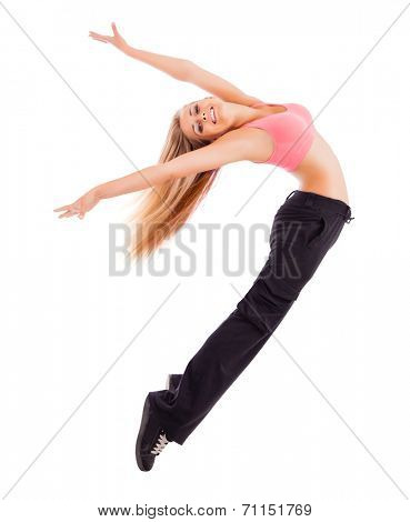 Young happy woman jumping high isolated on white.