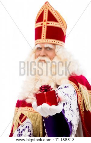 sinterklaas  with gift . typical Dutch character part of a traditional event celebrating the birthday of Sinterklaas (Santa Claus) in december.Selective focus on gift