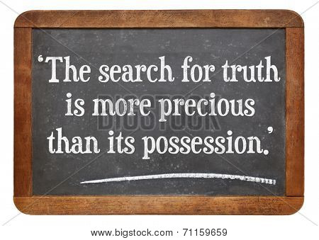 the search for truth is more precious than its possession - a quote from Albert Einstein on a vintage slate blackboard