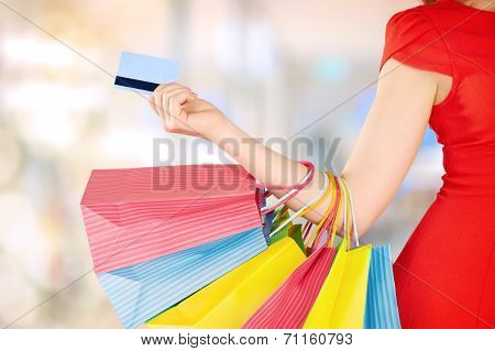 Happy Woman On Shopping With Bags And Credit Cards, Christmas Sales, Discounts