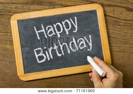 A blackboard with the text Happy Birthday